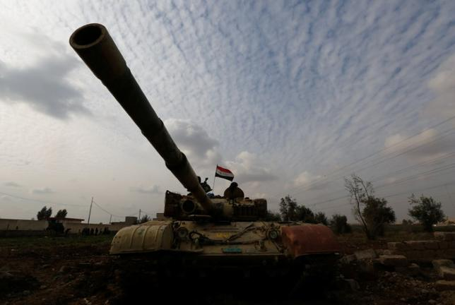 A tank of Iraqi army is seen during a fight with Islamic State militants in Rashidiya, North of Mosul, Iraq, January 30, 2017. REUTERS/Muhammad Hamed