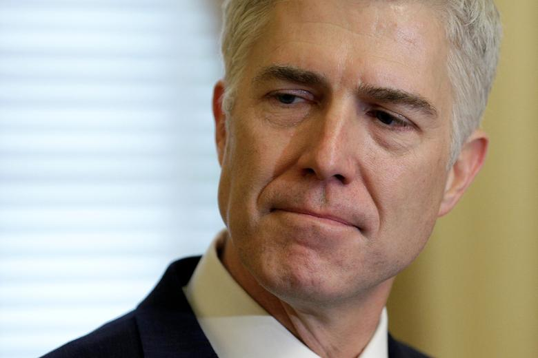 FILE PHOTO: Supreme Court Nominee Judge Neil Gorsuch arrives for a meeting with Senate Majority Leader Mitch McConnell (R-KY) and U.S. Vice President Mike Pence on Capitol Hill in Washington, U.S., February 1, 2017.      REUTERS/Joshua Roberts