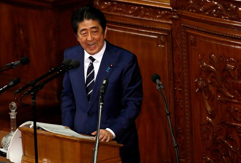 FILE PHOTO -  Japan's Prime Minister Shinzo Abe makes a policy speech at the start of the ordinary session of parliament in Tokyo, Japan, January 20, 2017. REUTERS/Toru Hanai/File Photo