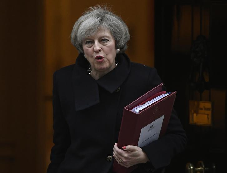 Britain's Prime Minister Theresa May leaves Number 10 Downing Street to attend Prime Minister's Questions at parliament in London, Britain, February 8, 2017. REUTERS/Toby Melville