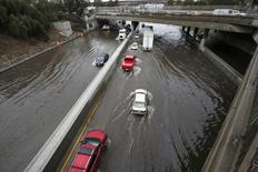 Vehicles drive on the flooded 5 freeway after an El Nino-strengthened storm brought rain to Los Angeles, California, United States, January 6, 2016. REUTERS/Lucy Nicholson