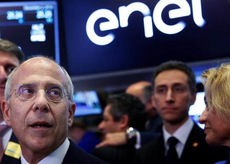 Francesco Starace, CEO and general manager of Enel Group, tours the trading floor at the New York Stock Exchange (NYSE) in New York City, U.S., December 2, 2016.  REUTERS/Brendan McDermid