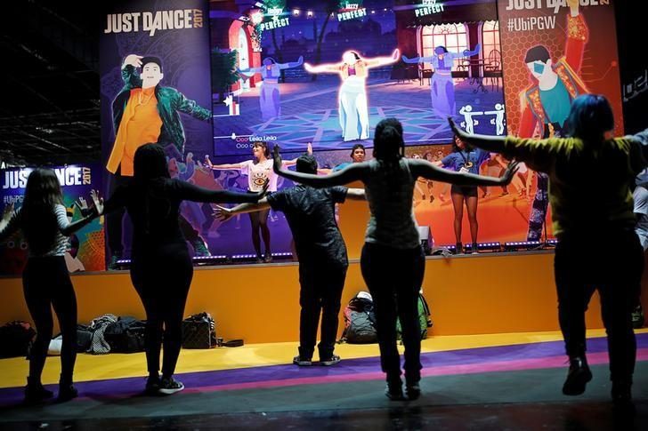 Visitors play Just Dance, a video game published by Ubisoft at the Paris Games Week, a trade fair for video games in Paris, France, October 26, 2016. REUTERS/Benoit Tessier/Files