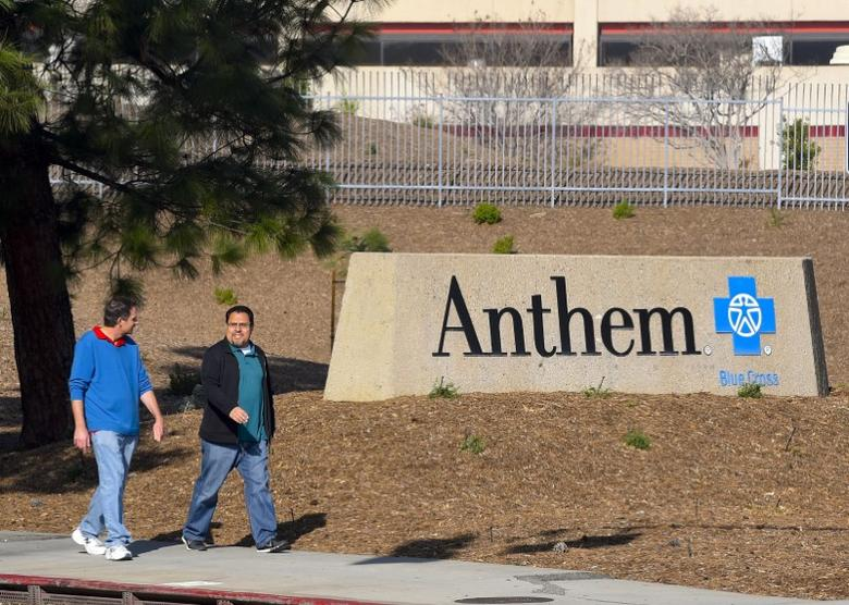 People walk past the office building of health insurer Anthem in Los Angeles, California February 5, 2015.  REUTERS/Gus Ruelas