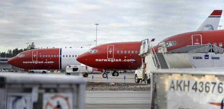 Parked Boeing 737-800 aircrafts belonging to budget carrier Norwegian Air are pictured at Stockholm Arlanda Airport, Sweden, March 6, 2015. REUTERS/Johan Nilsson/TT News Agency/File Photo