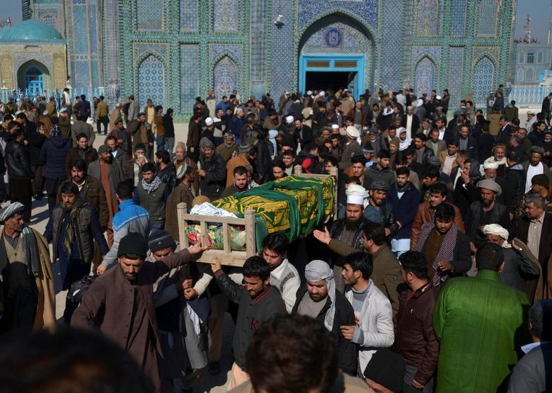 FILE PHOTO: Afghan men attend a funeral ceremony of an International Committee of the Red Cross (ICRC) employee, who was killed yesterday by gunmen in Mazar-i-Sharif, Afghanistan February 9, 2017. REUTERS/Stringer