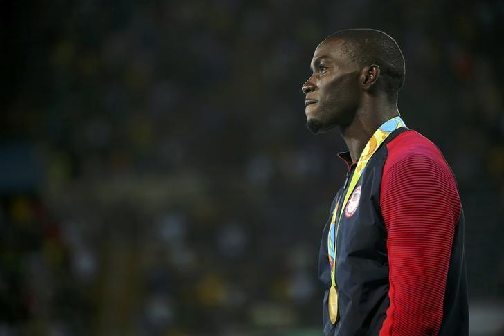 2016 Rio Olympics - Athletics - Victory Ceremony - Men's 400m Hurdles Victory Ceremony - Olympic Stadium - Rio de Janeiro, Brazil - 18/08/2016. Gold medalist Kerron Clement (USA) of USA reacts. REUTERS/Gonzalo Fuentes