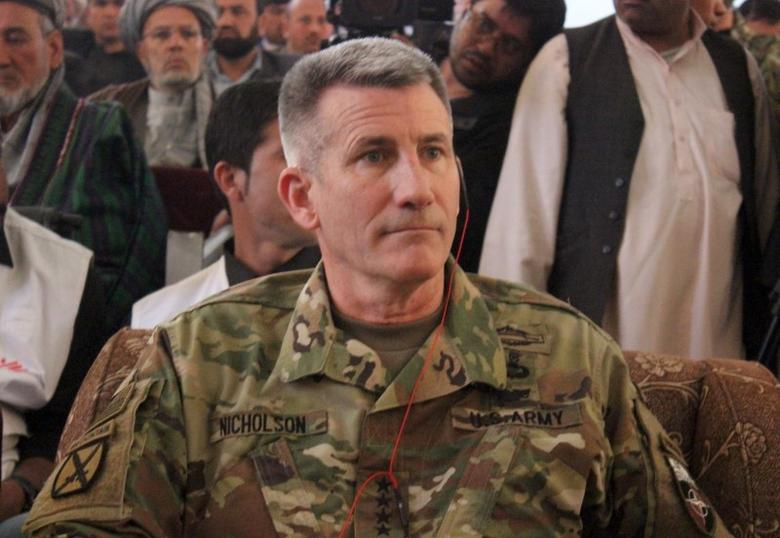 The commander of  U.S. and NATO forces in Afghanistan General John W. Nicholson sits during his visits from Kunduz province, Afghanistan, March 22, 2016. REUTERS/Stringer