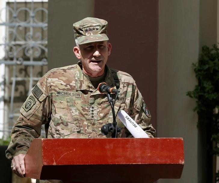 U.S. Army General John Nicholson, Commander of Resolute Support forces and U.S. forces in Afghanistan, speaks during a memorial ceremony to commemorate the 15th anniversary of the 9/11 attacks, in Kabul, Afghanistan September 11, 2016. REUTERS/Omar Sobhani/Files