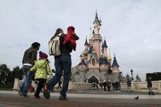 Visitors walk towards the Sleeping Beauty Castle during a visit to the Disneyland Paris Resort run by EuroDisney S.C.A in Marne-la-Vallee January 21, 2015. REUTERS/Gonzalo Fuentes