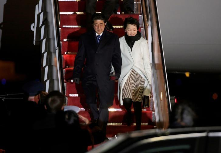 Japanese Prime Minister Shinzo Abe and his wife Akie Abe arrive ahead of his meeting with U.S. President Donald Trump, at Joint Base Andrews, Maryland, U.S., February 9, 2017. REUTERS/Joshua Roberts