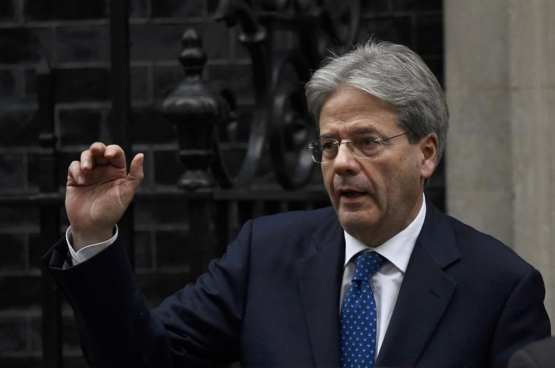 Italy's Prime Minister Paolo Gentiloni waves as he leaves after meeting his counterpart from Britain Theresa May at Number 10 Downing Street in London, February 9, 2017. REUTERS/Toby Melville