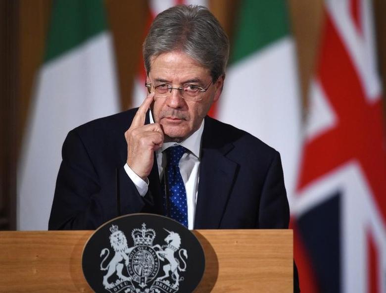 Italy's Prime Minister Paolo Gentiloni holds a press conference with his counterpart from Britain Theresa May (not shown) at Number 10 Downing Street in London, February 9, 2017. REUTERS/Facundo Arrizabalaga/Pool -