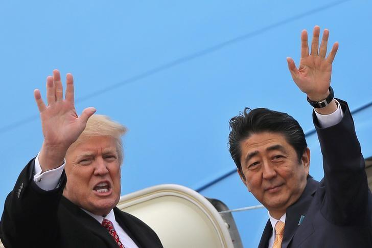 U.S. President Donald Trump and Japanese Prime Minister Shinzo Abe wave while boarding Air Force One as they depart for Palm Beach, Florida, at Joint Base Andrews, Maryland, U.S., February 10, 2017. REUTERS/Carlos Barria