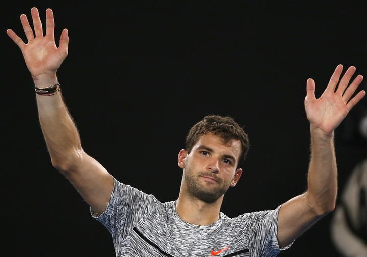 FILE PHOTO - Tennis - Australian Open - Melbourne Park, Melbourne, Australia - early 28/1/17 Bulgaria's Grigor Dimitrov waves as he leaves the court, after losing to Spain's Rafael Nadal in their Men's singles semi-final match. REUTERS/Issei Kato