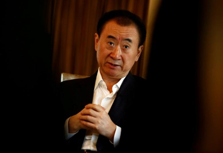 FILE PHOTO: Wang Jianlin, chairman of the Wanda Group, speaks during an interview in Beijing, China, August 23, 2016. REUTERS/Thomas Peter/File Photo