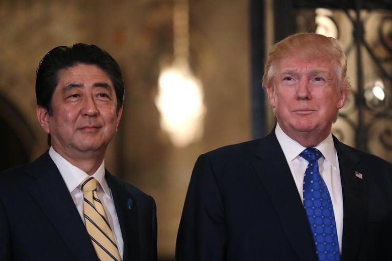 Japanese Prime Minister Shinzo Abe and U.S. President Donald Trump pose for a photograph before attending dinner at Mar-a-Lago Club in Palm Beach, Florida, U.S., February 11, 2017. REUTERS/Carlos Barria
