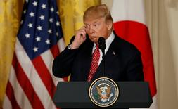 U.S. President Donald Trump holds his earpiece during a joint news conference with Japanese Prime Minister Shinzo Abe (not pictured) at the White House in Washington, U.S., February 10, 2017. REUTERS/Jim Bourg