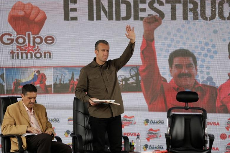 Venezuela's Vice President Tareck El Aissami (C) attends the swearing-in ceremony of the new board of directors of Venezuelan state oil company PDVSA, next to Ramon Lobo, Venezuela's Economy Vice President, in Caracas, Venezuela January 31, 2017. REUTERS/Marco Bello