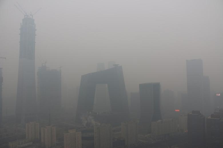 Buildings are seen in smog during a polluted day in Beijing, China, January 26, 2017. Picture taken January 26, 2017. REUTERS/Stringer