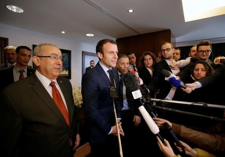 Emmanuel Macron (C), head of the political movement En Marche!, or Onwards!, and candidate for the 2017 presidential elections, attends a news conference at El Aurassi hotel in Algiers, Algeria February 13, 2017. REUTERS/Ramzi Boudina.
