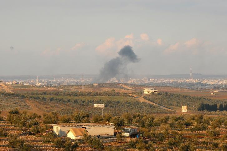 Smoke rises after strikes on rebel-held Deraa city, Syria February 13, 2017. REUTERS/Alaa Al-Faqir