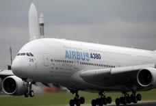 FILE PHOTO - An Airbus A380 aircraft takes part in a flight display during the 48th Paris Air Show at the Le Bourget airport near Paris June 18, 2009. REUTERS/Pascal Rossignol/File photo