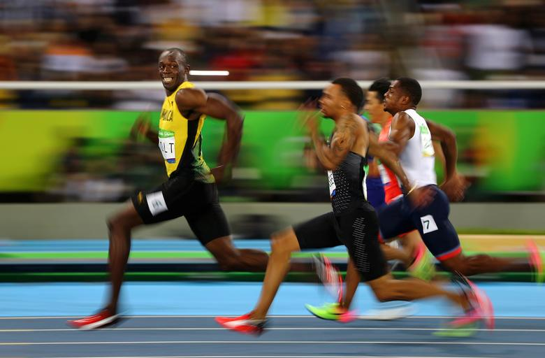 Usain Bolt of Jamaica smiles as he looks back at his competition, whilst winning the 100-meter semi-final sprint, at the 2016 Olympics in Rio de Janeiro, Brazil. Bolt is regarded as the fastest human ever timed. REUTERS/Kai Pfaffenbach