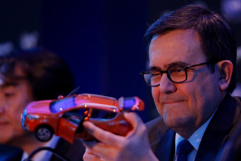 Mexico's Economy Minister Ildefonso Guajardo holds the model of a car during a news conference to announce the new plant of JAC Motors in Mexico City, Mexico, February 1, 2017. REUTERS/Carlos Jasso