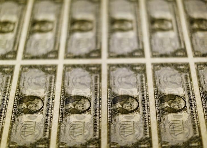 United States one dollar bills are seen on a light table at the Bureau of Engraving and Printing in Washington in this November 14, 2014, file photo. REUTERS/Gary Cameron/Files