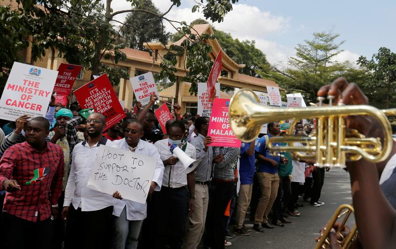 A brass band leads striking doctors chanting slogans outside the Court of Appeal as they wait for the release of jailed officials of the national doctors' union in their case to demand fulfilment of a 2013 agreement between their union and the government that would raise their pay and improve working conditions in Nairobi, Kenya, February 15, 2017. REUTERS/Thomas Mukoya