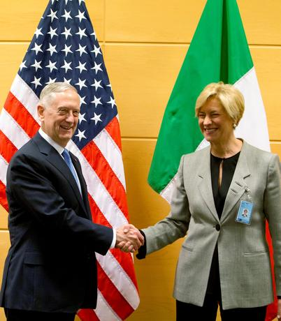 U.S. Defense Secretary James Mattis poses with Italian Defence Minister Roberta Pinotti during a NATO defence ministers meeting at the Alliance headquarters in Brussels, Belgium, February 15, 2017. REUTERS/Virginia Mayo/Pool