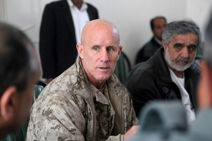 Vice Adm. Robert S. Harward, commanding officer of Combined Joint Interagency Task Force 435, speaks to an Afghan official during his visit to Zaranj, Afghanistan, in this January 6, 2011 handout photo.    Sgt. Shawn Coolman/U.S. Marines/Handout via REUTERS/Files
