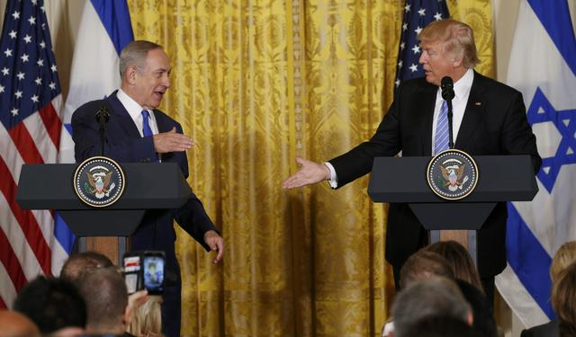 U.S. President Donald Trump (R) greets Israeli Prime Minister Benjamin Netanyahu after a joint news conference at the White House in Washington, U.S., February 15, 2017.   REUTERS/Kevin Lamarque