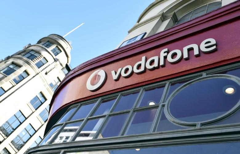 Branding for Vodafone is seen on the exterior of a shop in London, Britain, September 10, 2015.REUTERS/Toby Melville