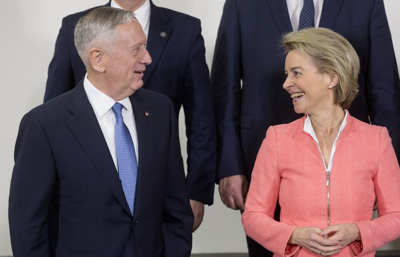 U.S. Defense Secretary Jim Mattis and German Defence Minister Ursula von der Leyen take places for a group picture during a NATO defence ministers meeting at the Alliance's headquarters in Brussels, Belgium February 15, 2017.  REUTERS/Thierry Monasse