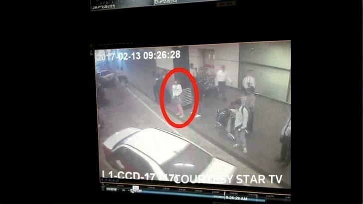 A woman who was detained at Kuala Lumpur airport, identified from CCTV footage at the airport and who was alone when she was apprehended, according to police in a statement, is seen circled in red in this still frame taken from video released February 16, 2017, showing CCTV footage courtesy of Star TV. STAR TV Via REUTERS TV
