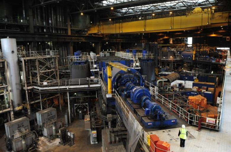 A generator is seen inside Drax power station in Drax, northern England, February 16, 2011.  REUTERS/Nigel Roddis