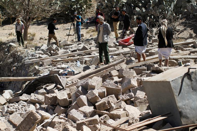 People walk on the rubble of a house destroyed by a Saudi-led air strike in Sanaa, Yemen February 2, 2017. REUTERS/Mohamed al-Sayaghi