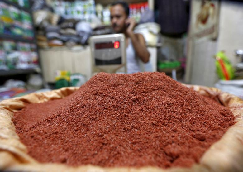 FILE PHOTO: A shopkeeper speaks on his mobile phone next to a sack filled with potash for sale in Kolkata, India, February 17, 2016. REUTERS/Rupak De Chowdhuri/File photo