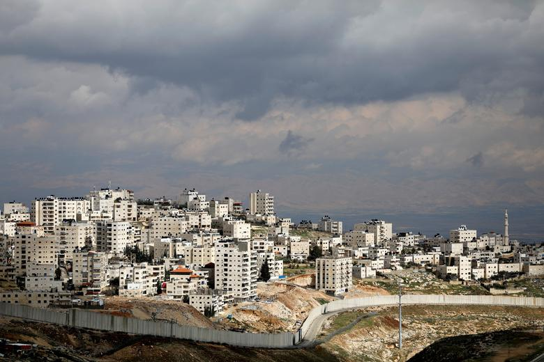 A general view picture shows the Israeli barrier running along the East Jerusalem refugee camp of Shuafat, in an area Israel annexed to Jerusalem after capturing it in the 1967 Middle East war February 15, 2017. REUTERS/Ronen Zvulun