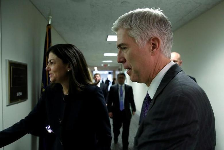 U.S. Supreme Court nominee Judge Neil Gorsuch arrives for a meeting with Senator Jeanne Shaheen (D-NH) on Capitol Hill in Washington, U.S., February 15, 2017. REUTERS/Yuri Gripas -