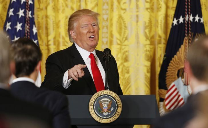 U.S. President Donald Trump gestures as he leaves the podium after a news conference at the White House in Washington, U.S., February 16, 2017.  REUTERS/Kevin Lamarque