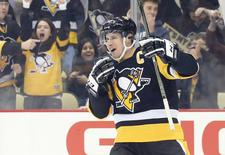 Feb 16, 2017; Pittsburgh, PA, USA;  Pittsburgh Penguins center Sidney Crosby (87) reacts after an assist on a goal by left wing Chris Kunitz (14) against the Winnipeg Jets during the first period at the PPG PAINTS Arena. Charles LeClaire-USA TODAY Sports