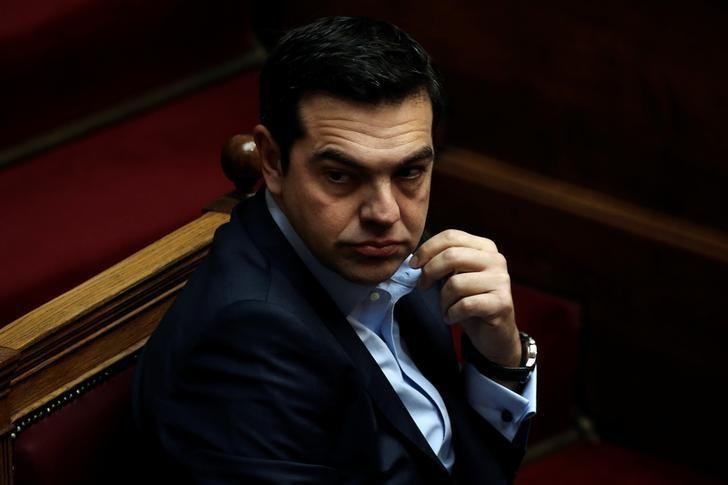 Greek Prime Minister Alexis Tsipras looks on before answering a question on corruption, during the Prime Minister's Question Time at the parliament in Athens, Greece, February 10, 2017. REUTERS/Alkis Konstantinidis