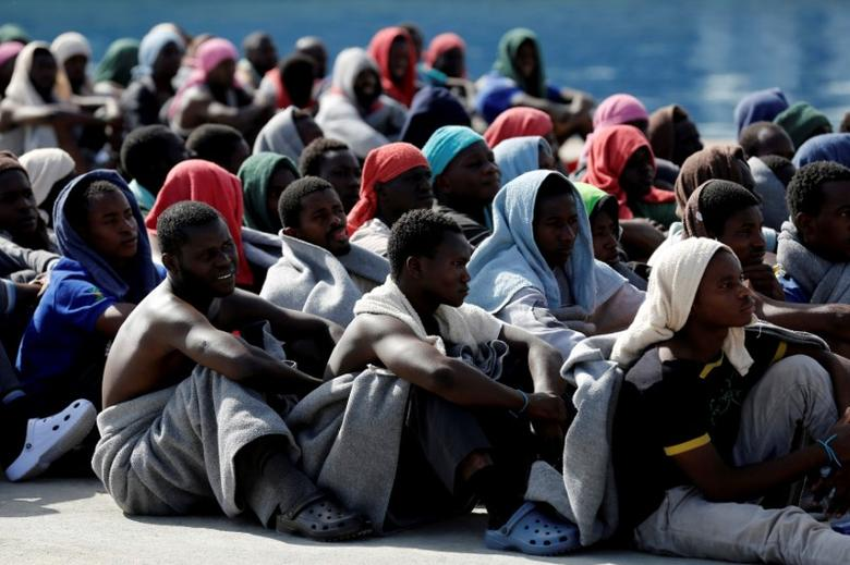 Migrants rests after disembarking from Dignity ship in the Sicilian harbour of Augusta, Italy, October 19, 2016.   REUTERS/Antonio Parrinello/File Photo