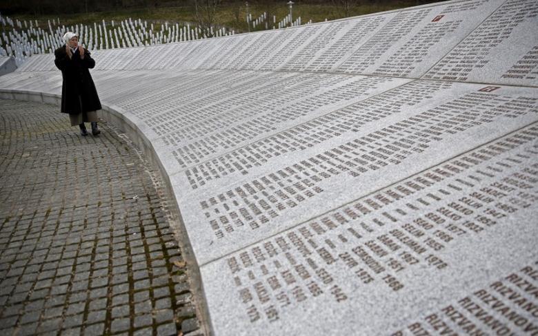 Fadila Efendic prays near memorial plaques at the Potocari genocide memorial centre near Srebrenica, March 18, 2015.  REUTERS/Dado Ruvic