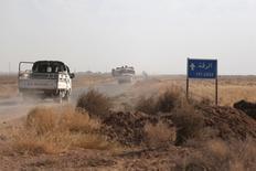 Vehicles drive on a road north of Raqqa city, Syria November 15, 2016. REUTERS/Rodi Said