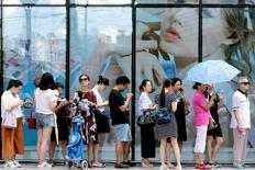 FILE PHOTO: People queue outside of a newly opened duty free shop in Shanghai, China, August 8, 2016.  China Daily/via REUTERS/File Photo