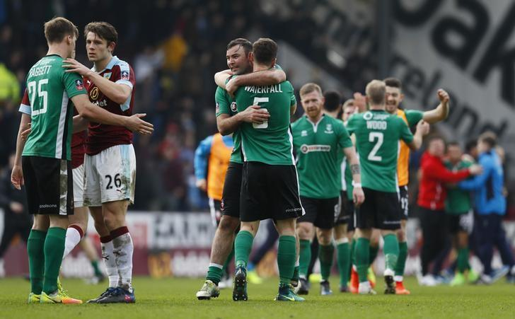 Britain Soccer Football - Burnley v Lincoln City - FA Cup Fifth Round - Turf Moor - 18/2/17 Lincoln's Matthew Rhead and teammates celebrate after the match as Burnley's James Tarkowski looks dejected  Action Images via Reuters / Jason Cairnduff Livepic